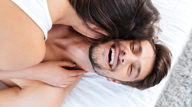 handsome man looking happy in bed | feature | Getting To Know The P Spot (Male G-Spot)