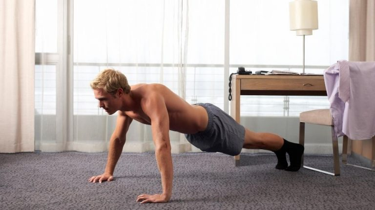 man working out canva featured photo | Feature | Build Your Own Workout Calendar Using These 5 Science-Backed Exercises