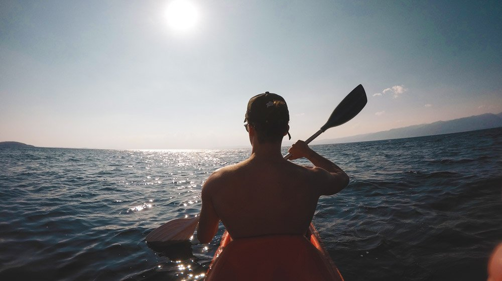 man sails kayak