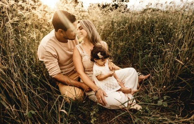 a couple sitting in the bush with a kid | Ways Your Husband Could Benefit From Health Optimization | 5 Ways Your Husband Could Benefit From Health Optimization