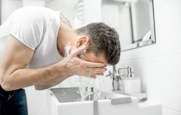 a guy washing his face | How to Treat Acne in Adult Males | How to Treat Acne in Men Fast
