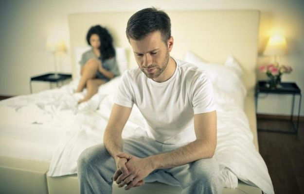 anxious man sat on the end of the bed and a woman sat behind him | What Are The Other Ways To Cure Erectile Dysfunction? | Can Apple Cider Vinegar Help Treat Erectile Dysfunction?