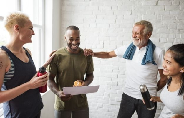 group of people laughing and talking after doing exercise | Enrich Your Social Circle | Maintain Your Physical Vitality with These 5 Life Hacks