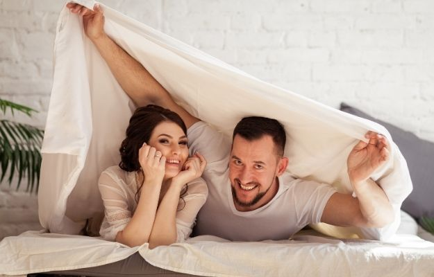 guy and girl are happy in white bed | Focus on What's In Front of You | Performance Anxiety ED: How to Overcome Fear Of Sex