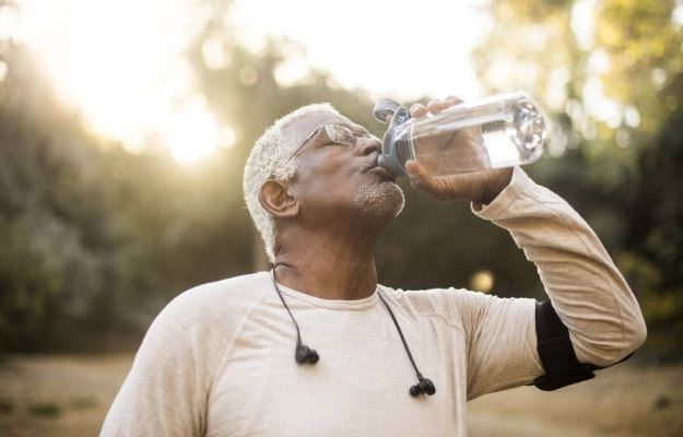 middle aged man drinking mineral water | Maintaining Your Rockstar Life | Live Like a Rock Star (and Still Be Healthy)