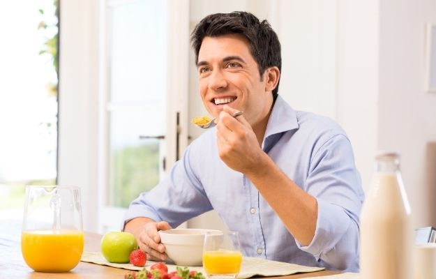 Happy Man Having Healthy Breakfast | How do You Develop a Holistic Lifestyle? | Why A Holistic Approach to Health is Important