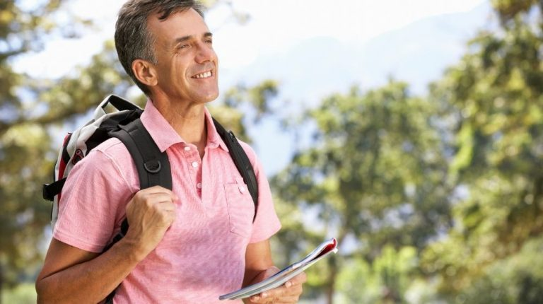 a cheerful man wearing backpack, holding notebook and enjoying natural life-feature-ca   Restore Your Natural Vibrant Energy With These 5 Tips