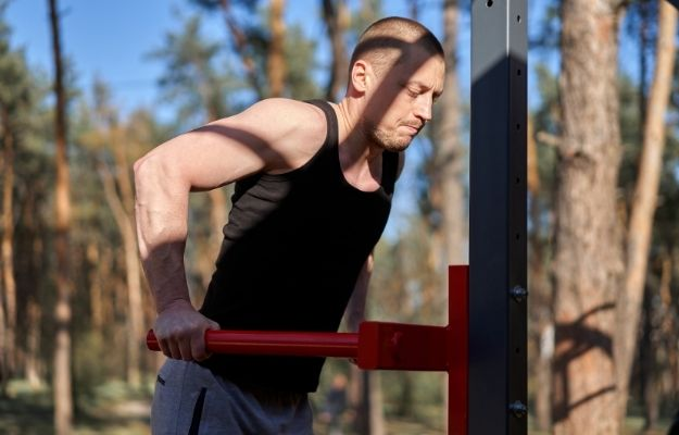 a guy doing body-building | Be Active and Keep Moving | Daily Strategies To Perform On Top Of Your Game
