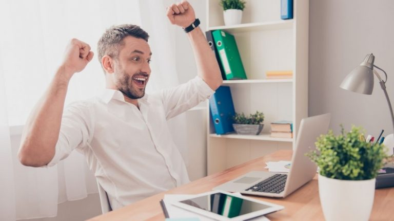 a guy looking at the screen and feeling cheerful | Feature | Daily Strategies To Perform On Top Of Your Game