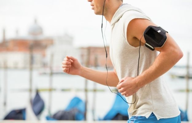 a man jogging outdoor while using health tracking technology   Outlook   Can AI Fitness Gadgets Improve Your Workout?