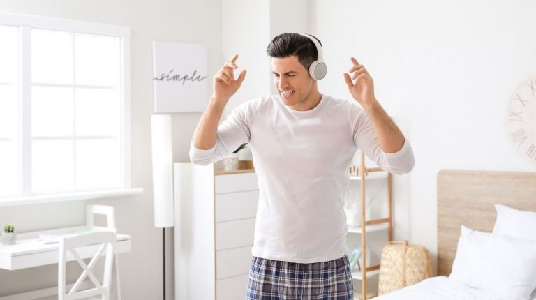 happy man listening and dancing at home | Feature | How To Have More Energy In The Morning