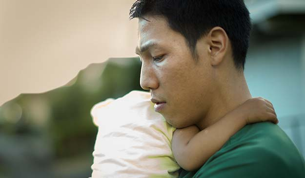 Distressed father holding his baby | Postpartum Depression: An Overview | Can Dads Get Postpartum Depression? | Can Dads Get Postpartum Depression?