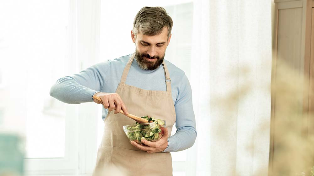 Middle-aged Man Making Salad The Best Diets for Men At Any Age | Feature | The Best Diets for Men At Any Age