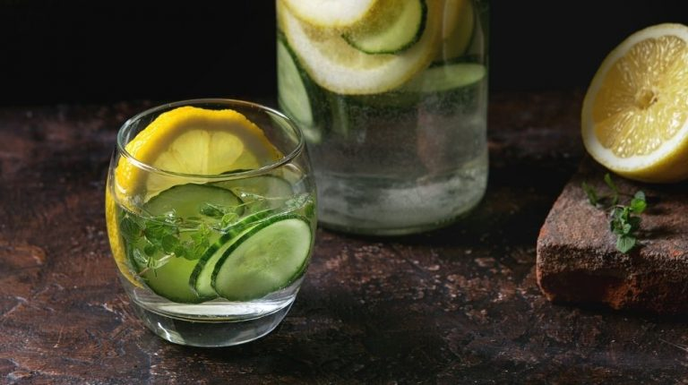 cup of water with slides of lime and lemon | Feature | 5 Drinks for Hangover Cure