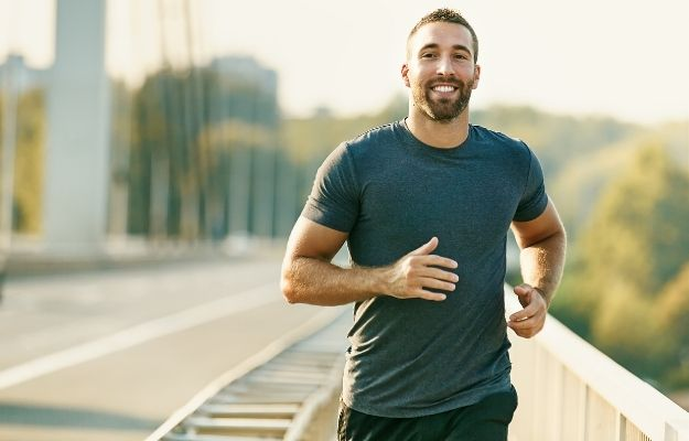 happy man is running on the bridge | Delays Neurodegeneration | Benefits of Spermidine for Cell Renewal