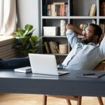 calm biracial man lean in chair relax rest at office desk | Feature | How to Decompress After a Long Day