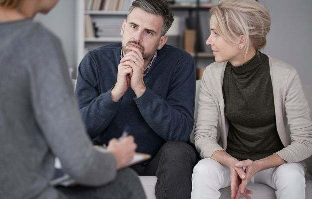 counselor is asking question with man sitting next to his wife | Talk Therapy or Counselling | Common ED Causes, Symptoms, and Treatments