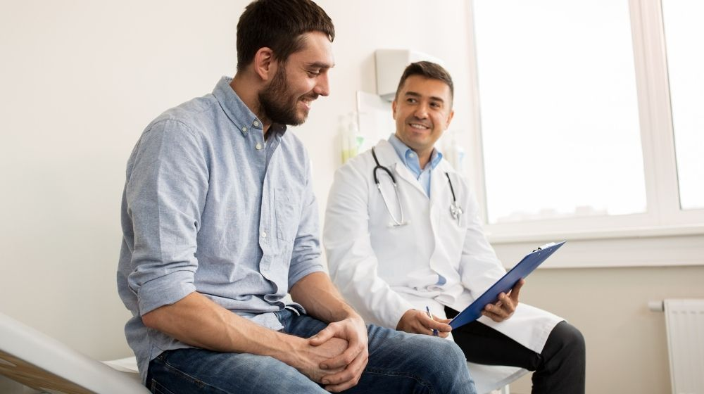 man is consulting with doctor | Feature | Benefits of Preventive Health Care