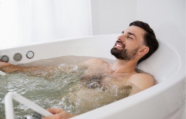 man is taking a warm soak | How to Decompress After a Long Day | How to Decompress After a Long Day