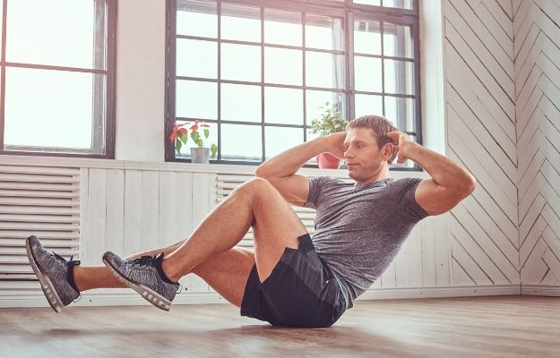 man is working out at home | Prevention | 5 Top Male Health Concerns and What You Can Do