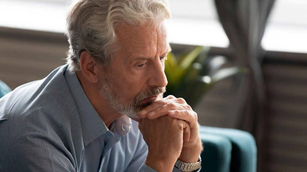 middle-aged-man-looking-absent-frustrated | Feature | What Causes Hypogonadism and How To Treat It
