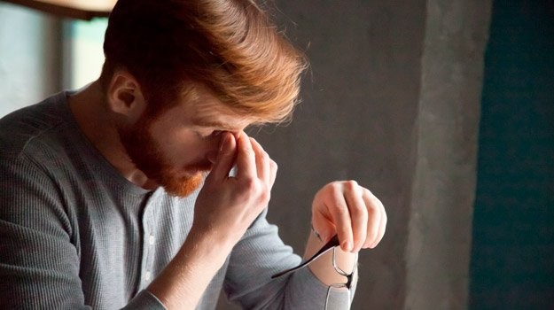 young-ginger-man-feeling-stressed-tired | What is Hypogonadism?| What Causes Hypogonadism and How To Treat It