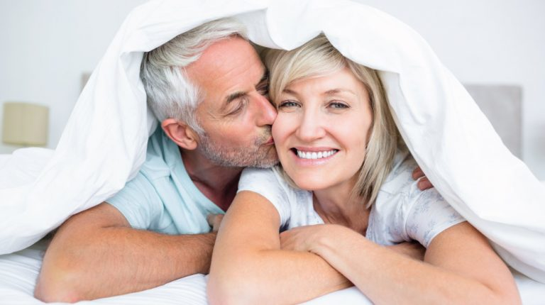 Mature couple on bed | Fearure | 5 Yoga Sex Positions To Help In The Bedroom