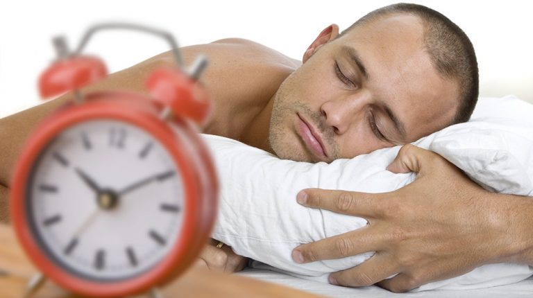 Middle Age man waking up late | Feature | Is Sleeping In Bad For Your Sleep Routine or Health