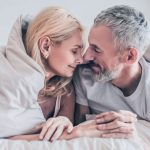 Happy morning. Middle-aged couple having romantic moment in bedroom | Feature | 3 Natural PDE5 Inhibitors for ED
