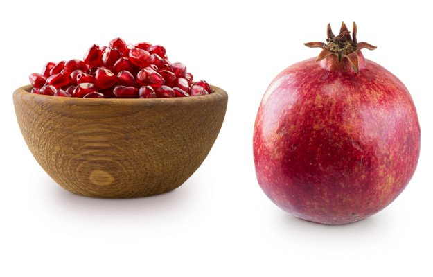 pomegranate and bowl with pomegranate seeds isolated on white background. Ripe pomegranates close-up. Sweet and juicy garnet with copy space for text. Garnet isolated on white. | 3 Natural PDE5 Inhibitors for ED