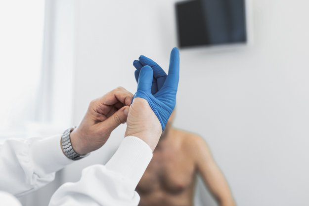 Doctor urologist puts a medical glove on the arm to examine the patient's prostate, prostate massage, lymphatic drainage.   Getting To Know The P Spot (Male G-Spot)