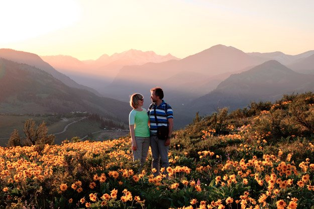 mature-couple-holding-each-other-in-flowery-outdoor-scenery-overcoming-intimacy-issues | How To Get Over Performance Anxiety and Intimacy Issues
