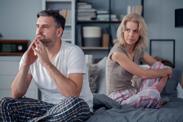 middle-aged-couple-turn-back-on-each-other-after-quarrel-ss-attachment-styles | How To Get Over Performance Anxiety and Intimacy Issues