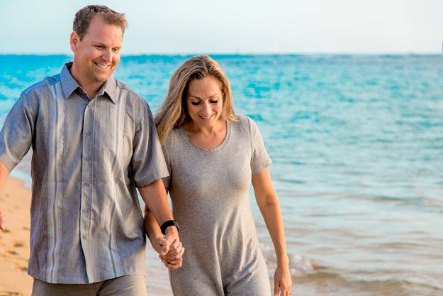 middle-aged-couple-walking-on-beach-while-holding-hands-ss-intimacy | How To Get Over Performance Anxiety and Intimacy Issues