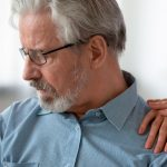 middle-aged-man-looking-anxious-with-woman-comforting-him | Feature | How To Get Over Performance Anxiety and Intimacy Issues