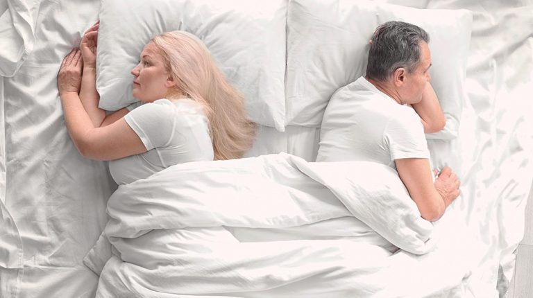 unhappy senior couple in bed | Feature | 6 Reasons Why Men Lose Interest in Sex