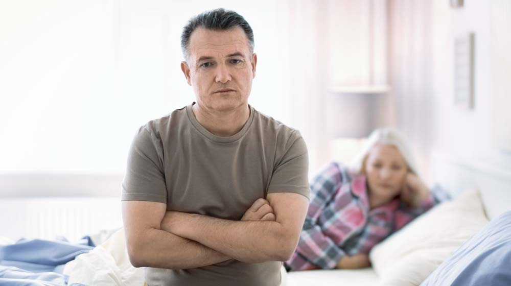 Senior,Couple,With,Problem,In,Relationship,On,Bed | Feature | Low Testosterone Symptoms in Men