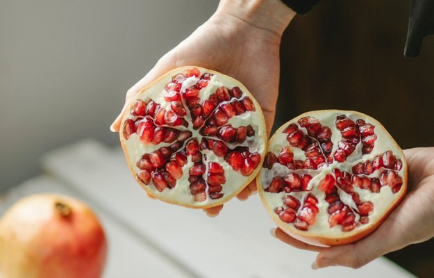 2 halves of pomegranates | Eat These 7 Foods To Boost Testosterone Naturally