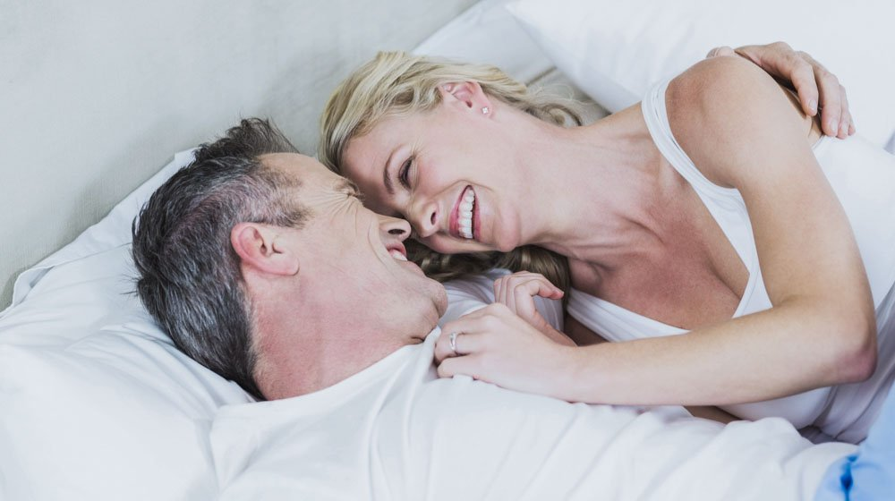 Cute,Couple,Cuddling,In,Bed,In,Their,Room | Feature | Eat These 7 Foods To Boost Testosterone Naturally