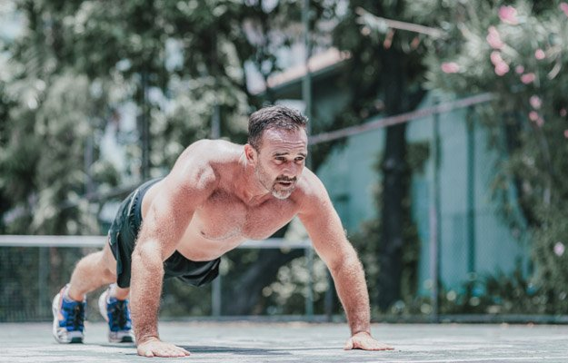 Fitness middle aged man doing push-ups. Male athlete exercising outdoors. Sports and active lifestyle. Body goals. Horizontal shot | 5 Simple Exercises for Building Muscles