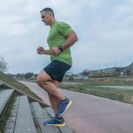 Mature muscular man dressed in sportswear doing a running exercise | Feature | 5 Simple Exercises for Building Muscles