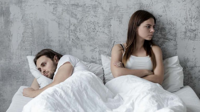 Sad millennial lovers after quarrel fight ignoring avoiding sex in bed, frustrated man and woman not talking feeling offended or stubborn, unhappy married couple and sexual problems concept | Feature | How Common is ED in Young Men
