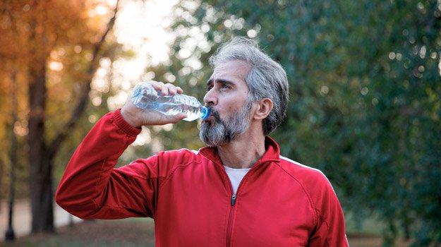Post-workout Nutrition: What Should I Eat After Exercise? | mature-man-drinking-water-after-workout-in-outdoor-autumn-scenery-ss | Don't Forget to Drink Plenty of Water