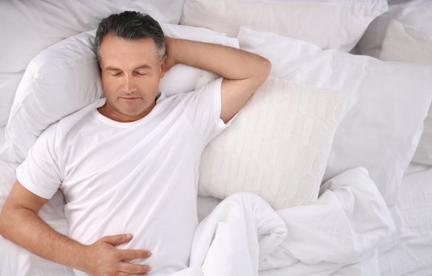 Man-sleeping-on-comfortable-pillow---------GET-ENOUGH-SLEEP_body | BLOG How To Balance Your Hormones | GET-ENOUGH-SLEEP