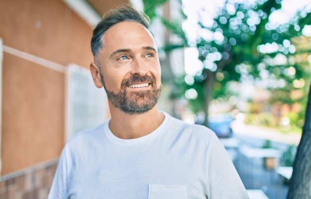 Middle-age-handsome-man-smiling-happy | The Game-Changing Benefits of TRT | Improved mood