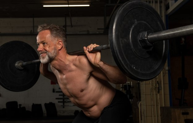 Portrait-of-a-middle-aged-strong-athlete-who-is-doing-weight-training-in-a-gym-----------BETTER-BALANCE-----------_body | The Benefits of Strength Training in Your 40's and 50's | BETTER-BALANCE