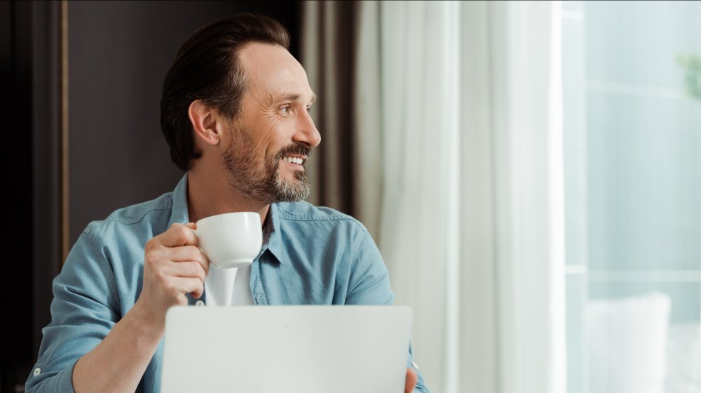 Selective-focus-of-smiling-man-drinking-coffee | Feature | The Game-Changing Benefits of TRT