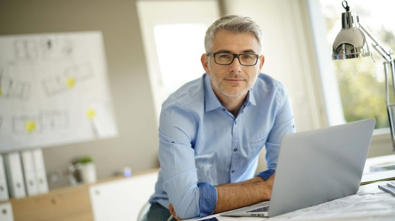 mature-man-with-room-background | BLOG How To Balance Your Hormones | feature