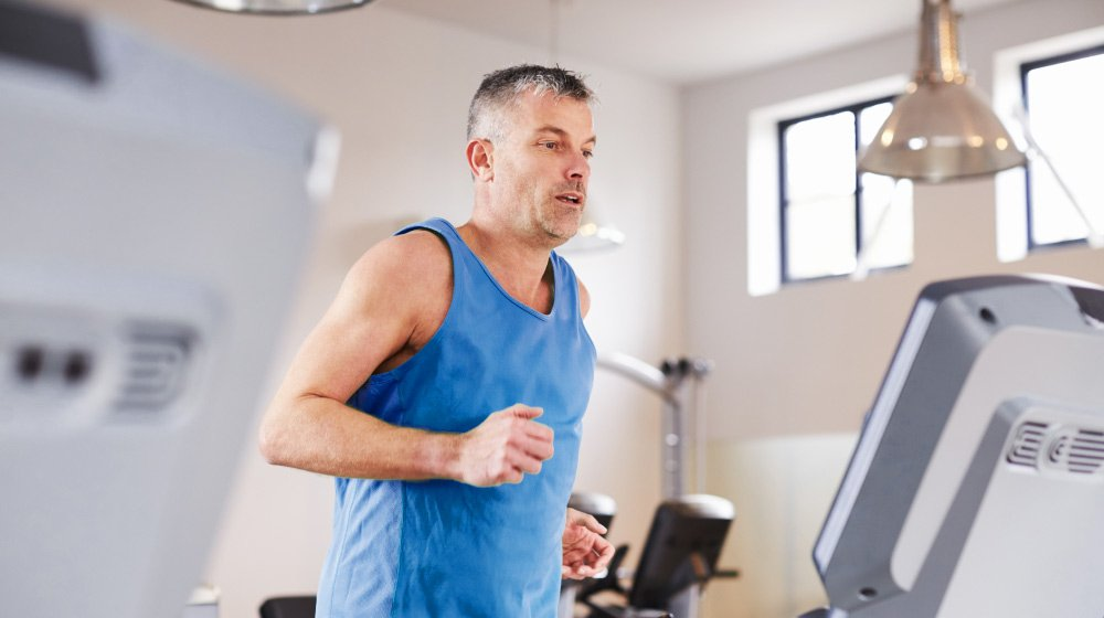 Mature-Man-Running_How-to-Tell-If-You-Are-Over-Exercising | feature | How to Tell If You Are Over-Exercising
