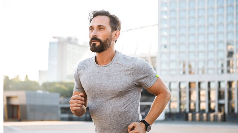 Young man running in the street | Feature | Low Impact Exercises That Keep You Fit